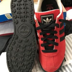 Adidas black, red and white tennis shoes